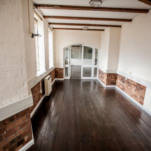 Exposed brick and natural wooden floors.